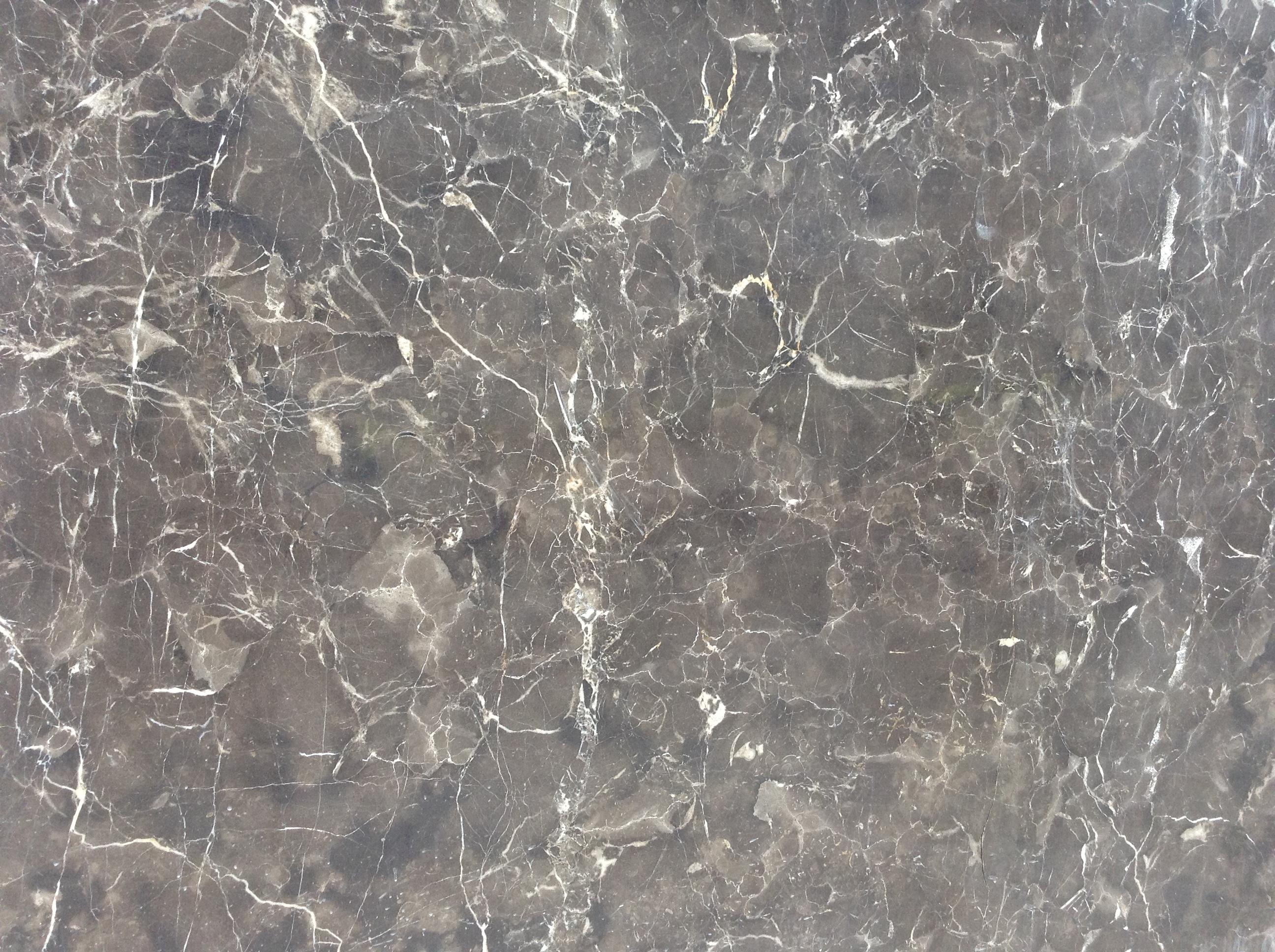 该款深啡网大理石的特点:板面色彩均匀、底色稍微偏黄、花纹偏大、白根不是很多 江西乐信石材厂集矿山开采、石材加工、进出口销售于一体。我们拥有自己的啡网纹矿山,矿源丰富,色彩均匀,色差较小,花纹美观。现产的深啡网纹大理石和浅网大理石等产品在国内广受好评,并且畅销欧美和中南亚。欢迎大家来电咨询。